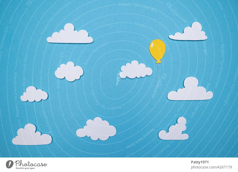 Balloon cut out of paper floats alone between fluffy clouds through the sky Lutballon Sky Clouds on one's own Lonely solo Deserted Paper Low-cut Loneliness Free