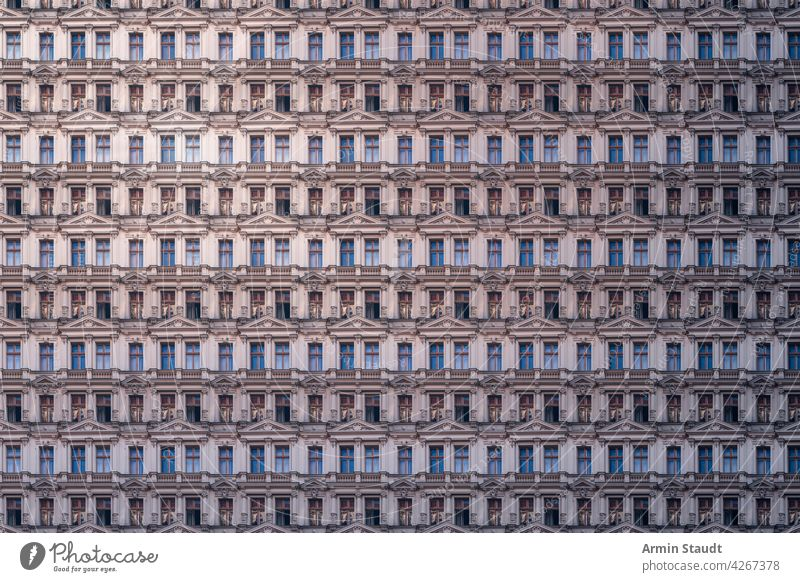 architectural pattern of an old luxury Berlin apartment building with stucco luxurious architecture berlin house facade historic weathered column pillar