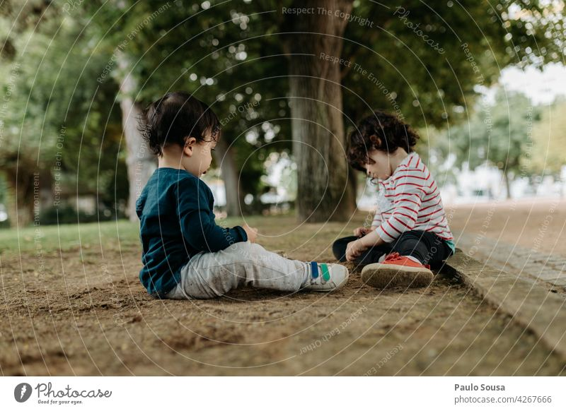 Brother and sister playing outdoors Brothers and sisters Park Playing Day Together Child Infancy Joy Colour photo Human being Exterior shot Friendship 2 Girl