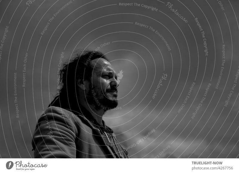 Foresight... Or: Where is the next mountain? Man portrait Black & white photo Half-profile Exterior shot Black-haired long hairs Facial hair concentrated