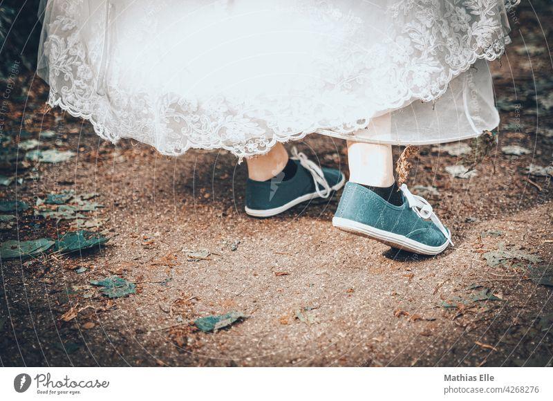 Wedding dress with sneakers Exterior shot Romance Detail Wedding anniversary Love Photo shoot Interest Optimism Joie de vivre (Vitality) Rebellious Positive