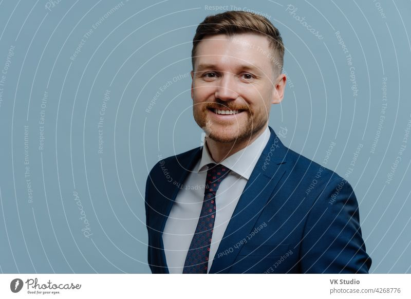 Portrait of happy handsome business man smiling at camera young successful businessman leader formal suit looking office confidence caucasian adult bearded male