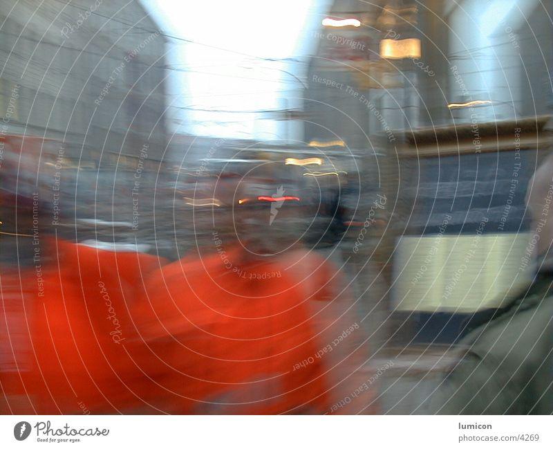 2 men in orange Blur Human being face