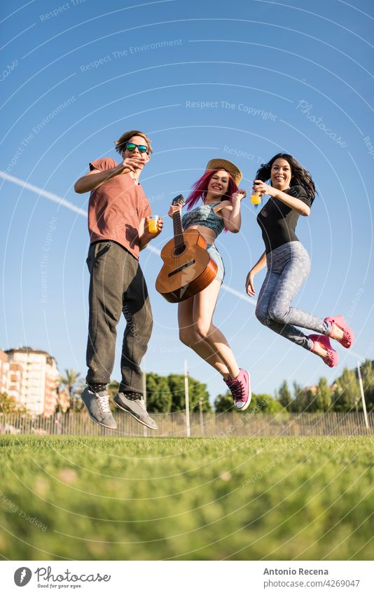 group of friends enjoy their free time in the park playing guitar and enjoying woman young attractive 20s people person youth urban women pretty pretty people