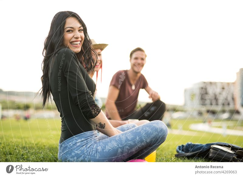 A group of young friends have refreshments in the park on a spring day outdoors woman attractive 20s joy people person youth urban women pretty pretty people