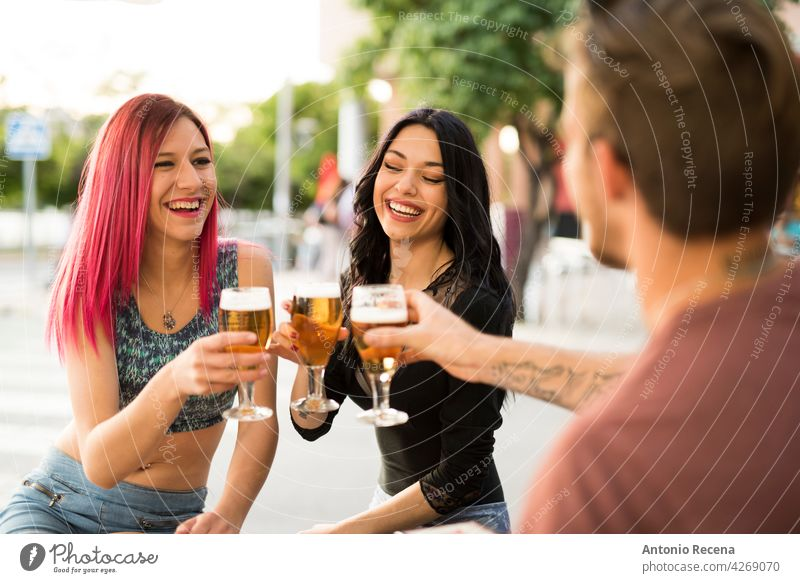Friends drinking beer having fun in bar terrace with beer woman young attractive 20s joy people person youth urban women pretty pretty people outdoors city