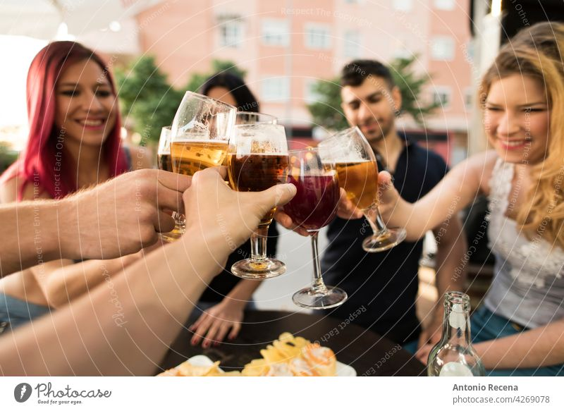 Group of friends making a toast with alcoholic drinks woman young attractive 20s joy people person youth urban women pretty pretty people outdoors city group