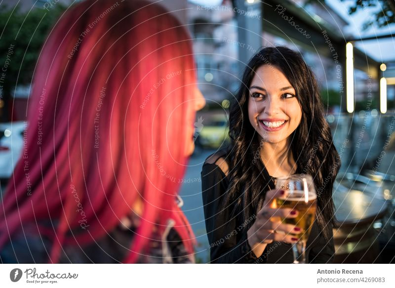 pretty women have a happy conversation in a bar woman young attractive 20s joy people person youth urban pretty people outdoors city beer terrace smile share