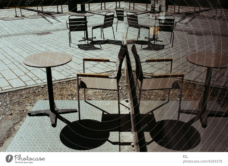 outdoor dining outside gastronomy Table Chair reflection Slice Empty forsake sb./sth. corona Gastronomy Restaurant Café Sidewalk café Closed Summer chairs