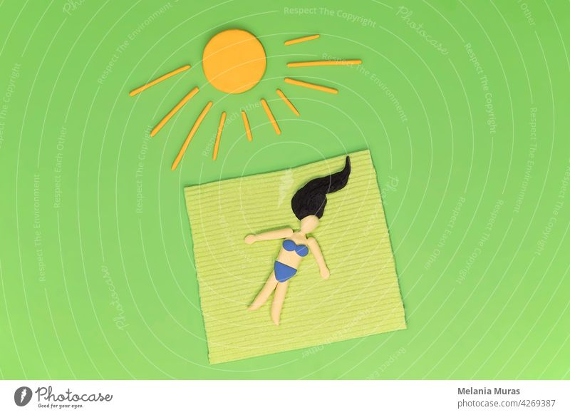 Woman laying in the grass on the blanket under yellow sun. Relax in the greenery, sunbathing, resting in garden concept. Artificial abstract scene, leisure in the green environment during vacations.