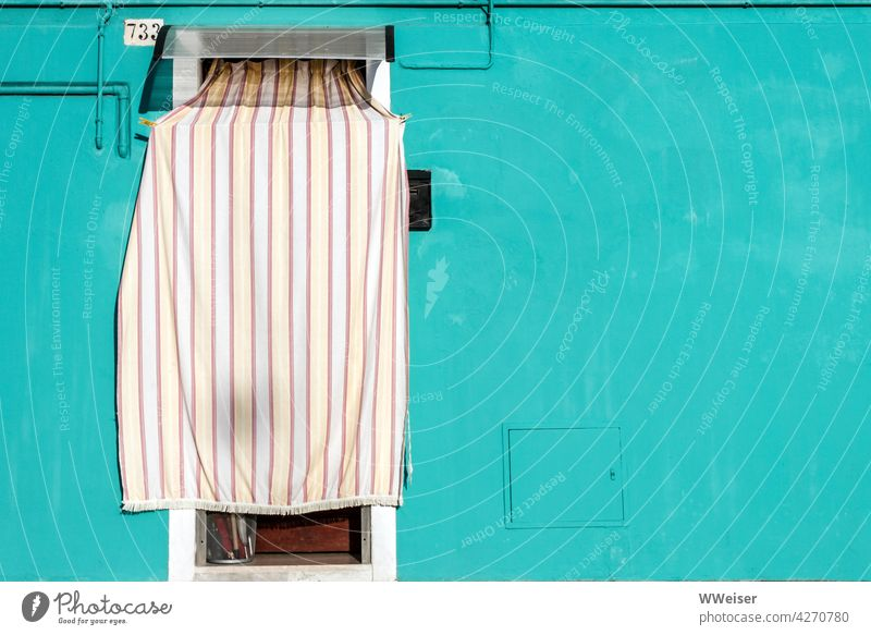 A curtain provides shade in the entrance area of this colorful house House (Residential Structure) Facade door Entrance Drape Hang Shadow Summer Hot warm