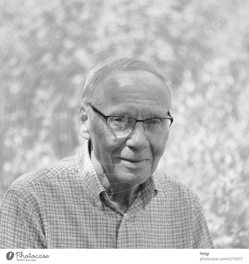 black and white portrait of friendly senior with glasses in nature Human being Man Senior citizen age masculine more adult Mature Old Retirement Smiling out