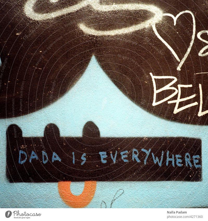 DADA Analog Analogue photo Colour writing Text Dada Wall (building) Letters (alphabet) Word Black White Orange Blue Facade Remark Colour photo Graffiti