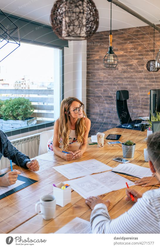 Businesswoman in a work meeting looking at construction drawings businesswoman architect boss presentation engineer teamwork cooperation brainstorming listening