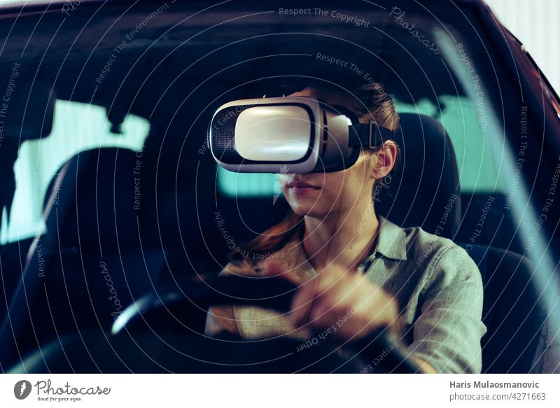 woman wearing 3d vr goggles, driving car in virtual space advanced safety vehicle automobile automotive black computer concept control cyber cyberspace digital