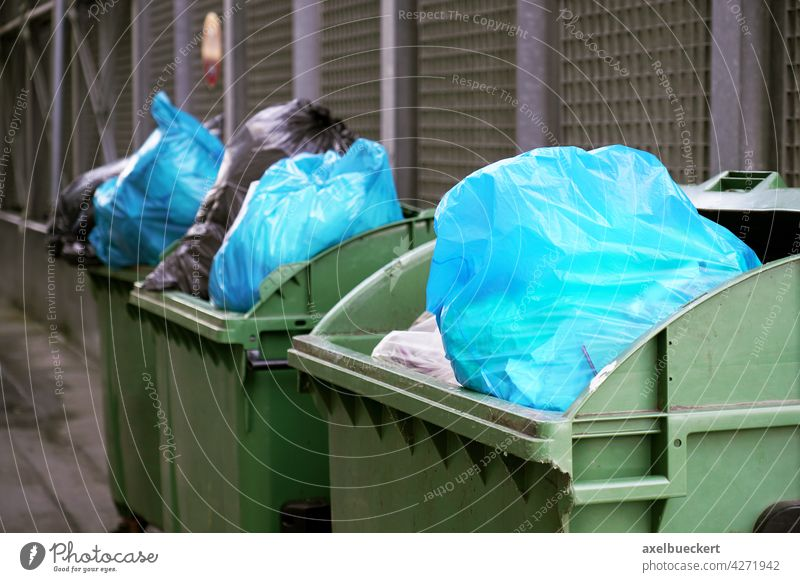 overfull garbage containers with garbage bags dustbin Garbage bag Trash Refuse disposal Trash container Waste management refuse sacks Environmental pollution