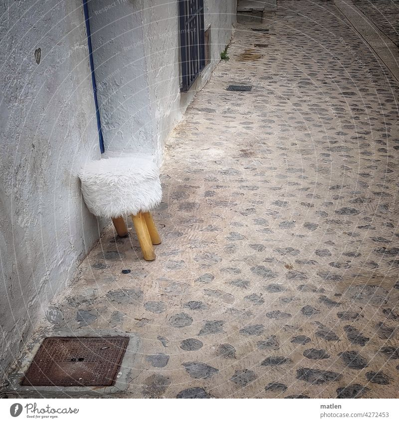 In need of support Requiring support Stool Street Seating Deserted Wall (building) Exterior shot Cobblestones Fur cover leg missing Old Facade Old town