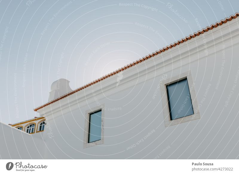 White building against the sky Building Wall (building) Architecture Facade Shadow Day Manmade structures Window Black & white photo