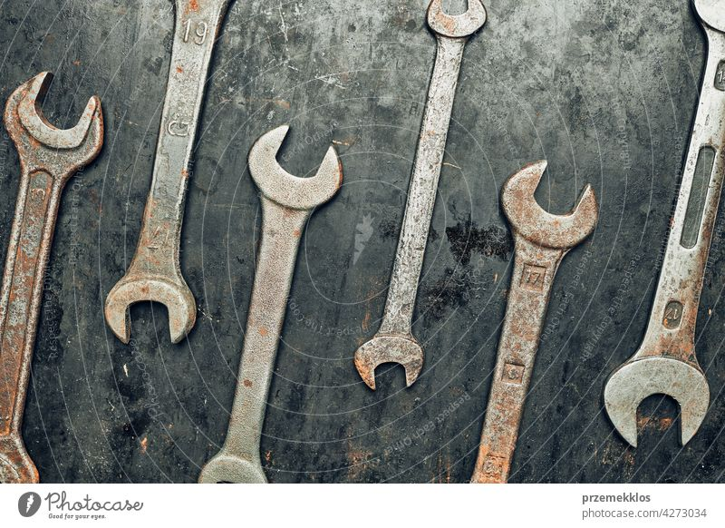 Spanners on steel surface. Old rusty wrenches for maintenance. Mechanic hardware tools to fix. Technical tools background metal iron used heavy useful workshop
