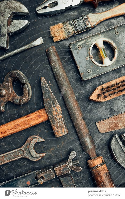 Old hardware tools. Wrench, screwdriver, measure, hammer, pliers on steel surface. Mechanic tools for maintenance. Hardware tools to fix. Technical background