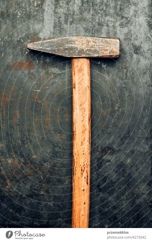 Old hammer on steel surface. Tool for maintenance. Hardware tool to fix. Technical background metal hardware iron old used heavy useful workshop improvement
