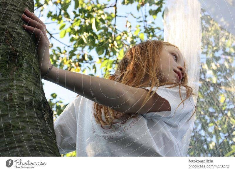 redhead girl climbing in a cherry tree Girl Summer romantic Dreamily Tree trunk bark Tree bark Treetop Summery Summer feeling Tree house holidays Garden out