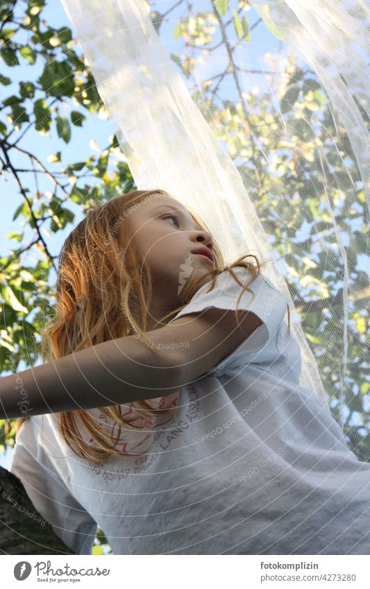 redhead girl with fly net in tree Girl Child Long-haired Red-haired Tree Mosquito net romantic Youth (Young adults) Human being look Nature Experiencing nature