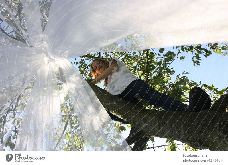 Teen girl climbing in a tall tree with a mosquito net hanging in it Mosquito net Girl Youth (Young adults) Feminine Young woman teenager Tree Climbing Net