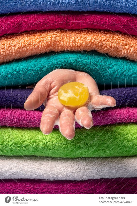 Personal hygiene concept. Washing hands with natural soap. background bar bath bathroom blue care clean close-up color copy space fabric fluffy folded