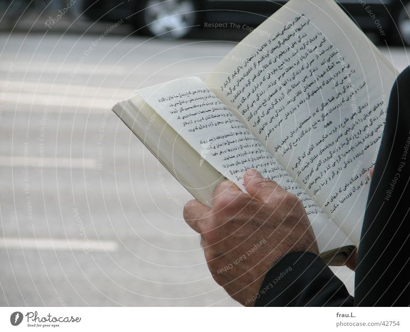 literature Poetic Smart Bus stop Book Man Hand Text Light Transport Reading Moral Persian literature days Street Life Sun Wait Car Arm