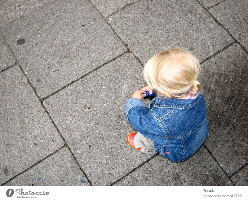 Child Red Girl Playing Hair and hairstyles Small Footwear Blonde Cute Things Concentrate Toddler Sidewalk Traffic infrastructure Crouch Crouching