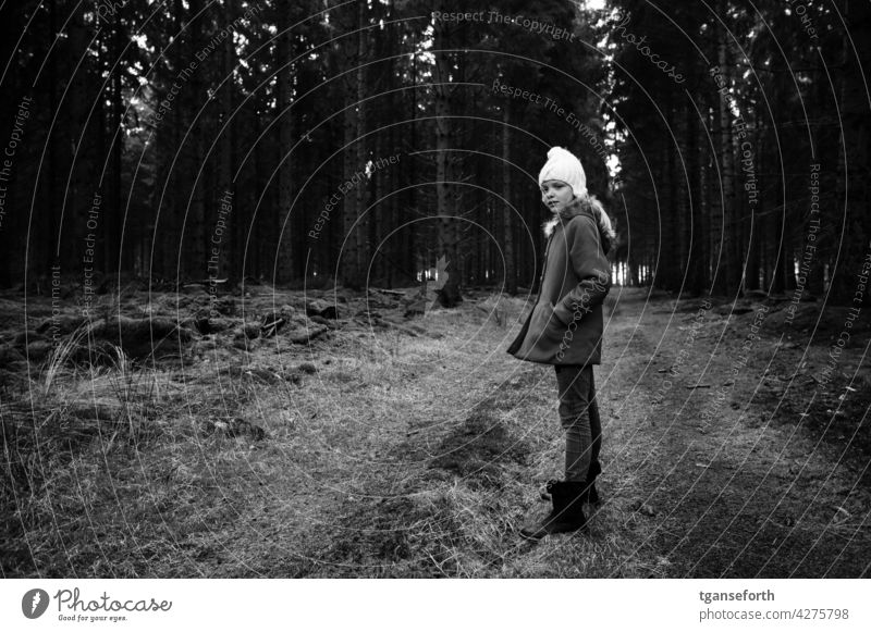 Winter walk in the forest Forest Child Cap Cold To go for a walk Walk in the nature Black & white photo forest path Nature Exterior shot trees Coat Hiking Tree