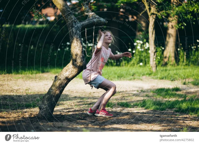 Child playing with a rope on an apple tree in the garden Playing Garden Tree Apple tree Colour photo Exterior shot Climbing To swing Joy Summer Happiness Nature