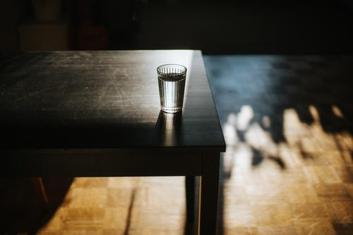 glass of fresh water on table beverage desk drink food and drink health heat high angle view horizontal hydrate indoor indoors liquid negative space object