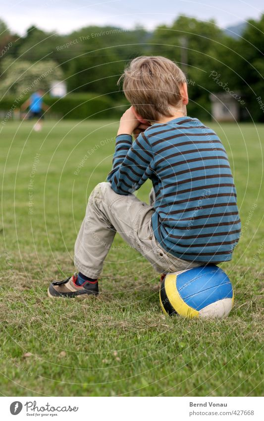 half Ball sports Sporting Complex Football pitch Masculine Child Boy (child) Infancy 1 Human being 3 - 8 years Sit Blue Multicoloured Yellow Gray Green White