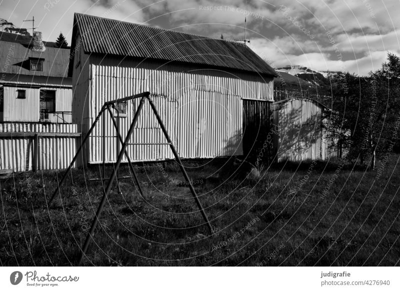Iceland House (Residential Structure) Corrugated sheet iron Corrugated iron wall Corrugated-iron hut corrugated sheet metal facade Swing Light Shadow Meadow
