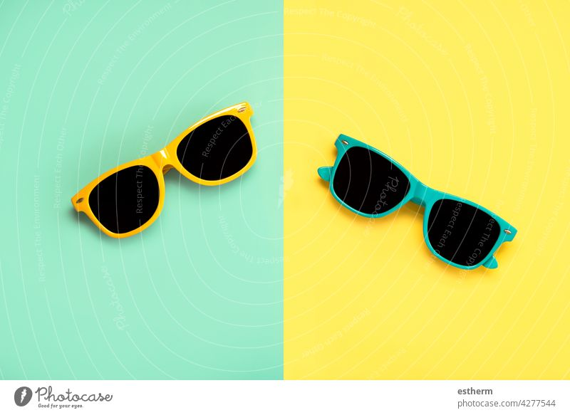 Top view of green and yellow sunglasses summer beach holidays creative pattern uv accessory protect eye wearing eyewear accessories protection nobody cool