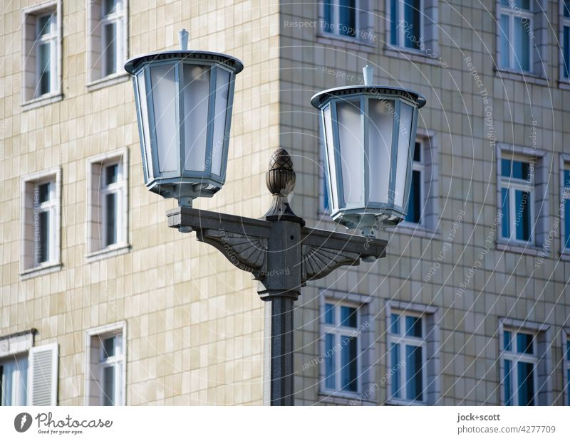 Paulick candelabra in front of socialist classicist facade Street lighting Lantern Karl-Marx-Allee Nostalgia Style Architecture GDR Past Historic Facade