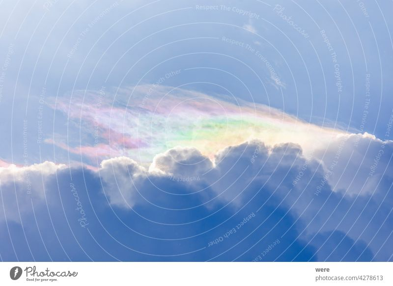 Feather clouds in delicate rainbow colors at the edge of a cumulus thundercloud Drops Raindrops cloud formation flare hail mighty mighty natural force nature