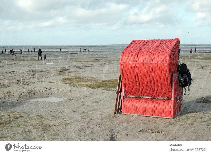 Lonely red beach chair at the beach of Bensersiel at the coast of the North Sea near Esens in East Frisia Beach Beach chair Red Autumn Sand Season