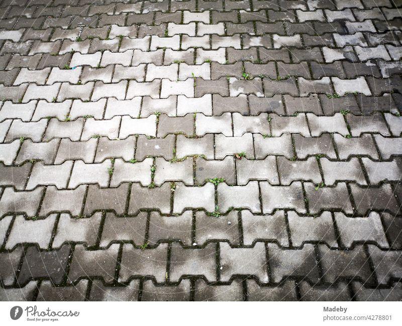 Drying grey interlocking pavement after rain in Adapazari, Sakarya province, Turkey paving composite paving Street off Sidewalk Pattern structure Surface Rhythm
