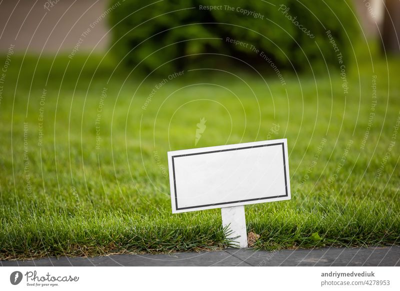 empty blank sign with space for text - photo. grass lawn green park garden warning notice nature off public keep field noticeboard post summer outdoors