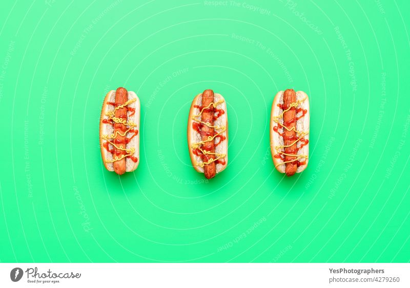 Hot dogs top view minimalist on a green table above american background bread bun calories color copy space cuisine cut out delicious eat fast fast-food