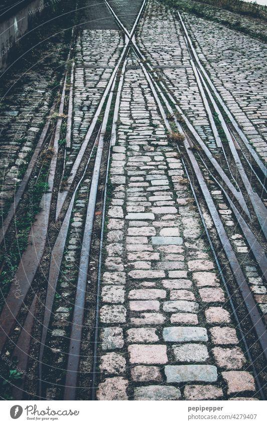 Tracks/rails with cobblestones Railroad tracks Rail transport Railroad system rail bed Train Transport Traffic infrastructure Train travel Exterior shot