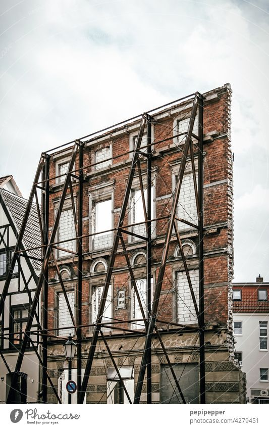 everything only facade - historical house wall secured by a steel construction Facade Architecture House (Residential Structure) Window Building Exterior shot