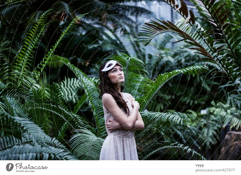 jungle drum Feminine Girl Young woman Youth (Young adults) 1 Human being 18 - 30 years Adults Nature Plant Bushes Virgin forest Dress Mask Observe Looking Stand