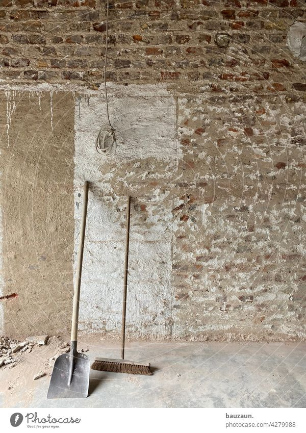 An old broom sweeps clean. Broom Construction site Wall (building) Craft (trade) Deserted Colour photo Work and employment Redecorate Wall (barrier)