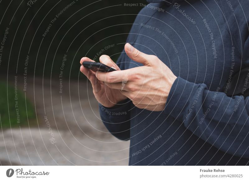 Close up of man busy with black smartphone mobile work hands Cellphone Technology Telephone Internet Hand using Lifestyle Communication Equipment copywriting