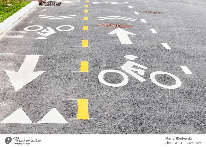 Asphalt bike lane in New York City, focus on the bike symbol, USA. street city bicycle road sign asphalt urban manhattan new york path transportation direction