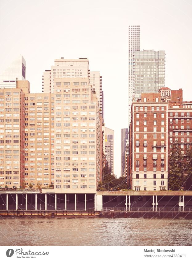 Residential buildings along East River waterfront, retro color toned picture, New York City, USA. city vintage apartment Manhattan NYC architecture urban
